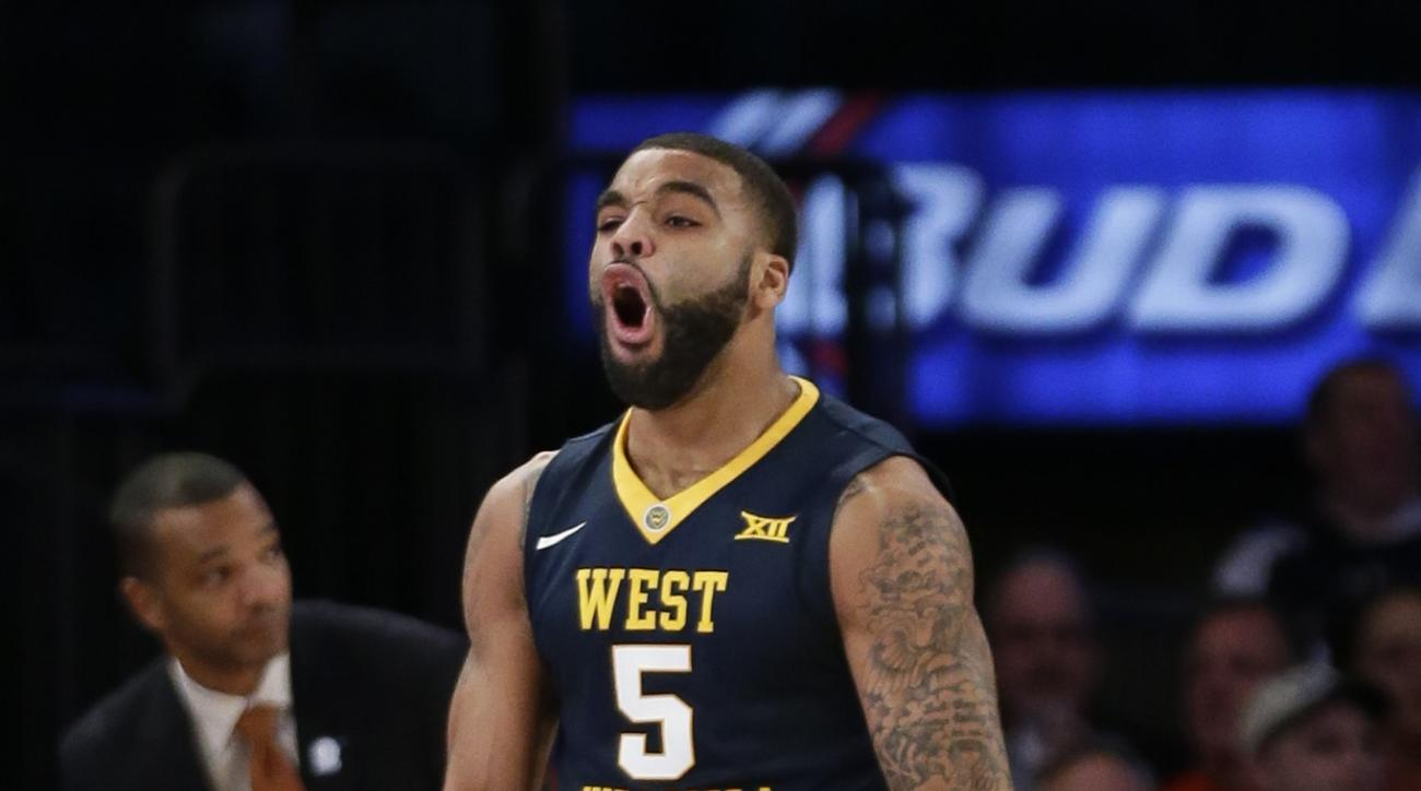 West Virginia's Jaysean Paige (5) celebrates after teammate Jevon Carter scored during the first half of an NCAA college basketball game against Virginia, Tuesday, Dec. 8, 2015, in New York. (AP Photo/Frank Franklin II)
