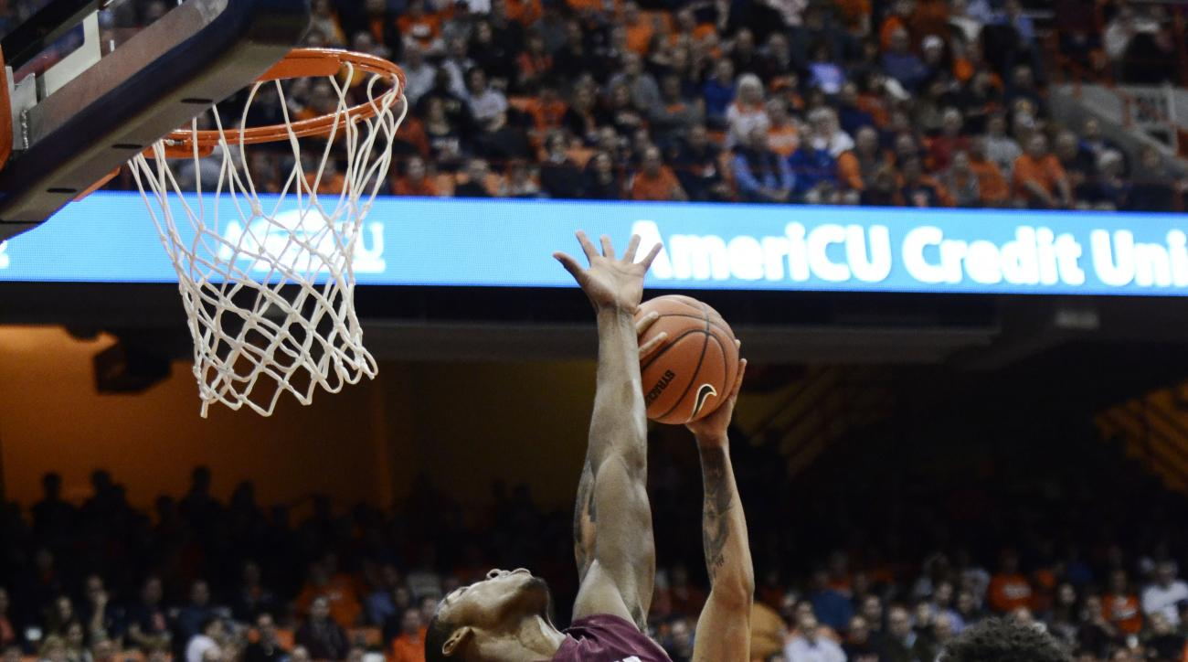Colgate's Jordan Swopshire, 15, attempts to block a pass caught by Syracuse's Michael Gbinije during their NCAA college basketball game at at the Carrier Dome in Syracuse, N.Y., Tuesday, Dec. 8 , 2015. (AP Photo/Heather Ainsworth)