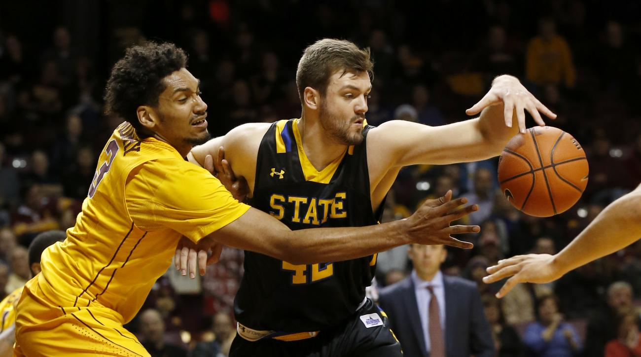Minnesota forward Jordan Murphy, left, and South Dakota State forward Ian Theisen, right,  reach for the ball during the first half of an NCAA college basketball game in Minneapolis, Tuesday, Dec. 8, 2015. (AP Photo/Ann Heisenfelt)
