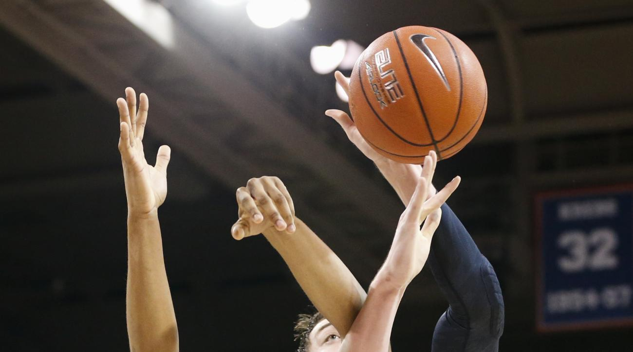 SMU forward Ben Moore (00) battles for a rebound against Michigan forward Ricky Doyle (32) during the first half of an NCAA college basketball game Tuesday, Dec. 8, 2015, in Dallas. (AP Photo/Jim Cowsert)