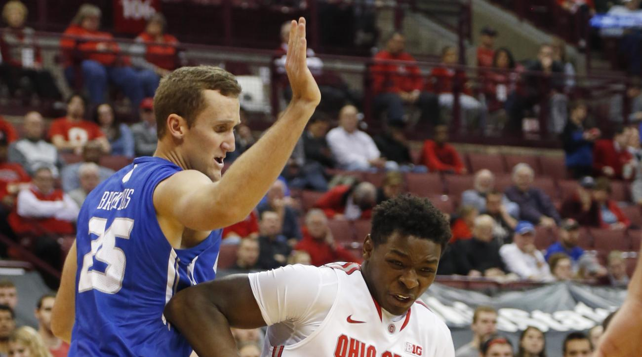 Ohio State's Jai'Sean Tate, right, drives to the basket against Air Force's Kyle Broekhuis during the second half of an NCAA college basketball game Tuesday, Dec. 8, 2015, in Columbus, Ohio. Ohio State won 74-50. (AP Photo/Jay LaPrete)