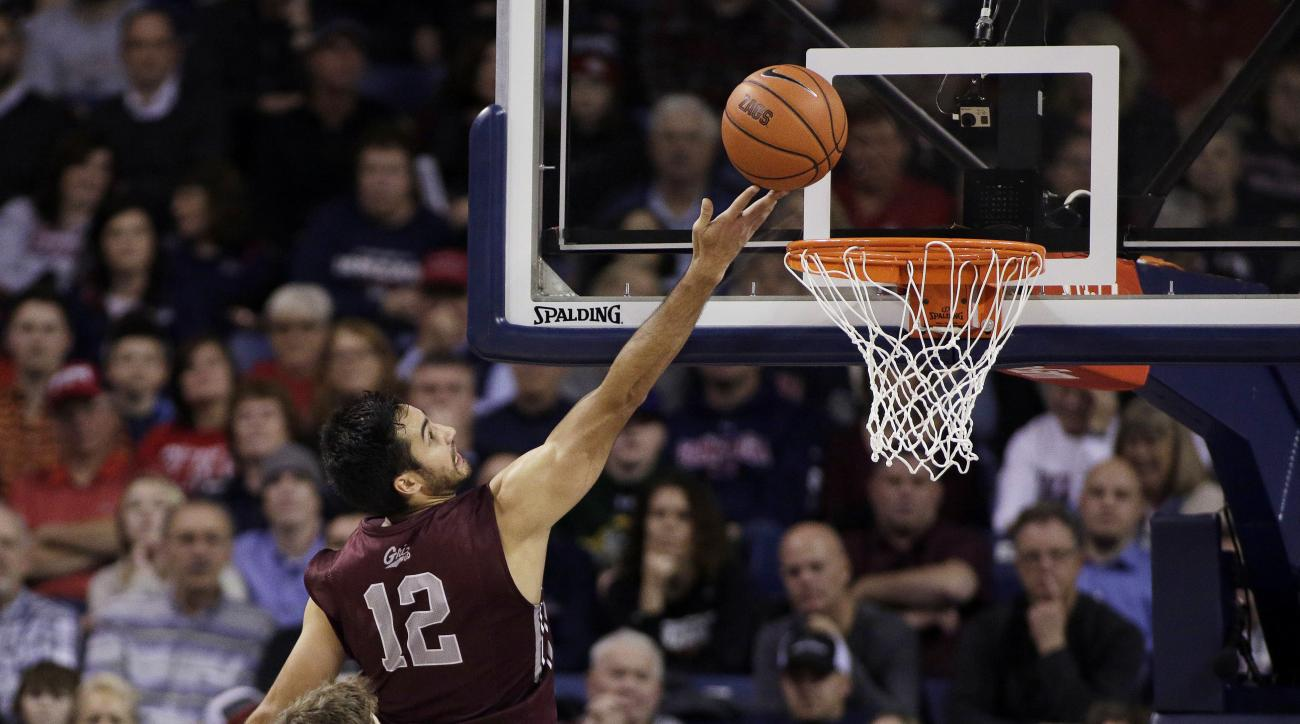 Montana's Martin Breunig (12) shoots in front of Gonzaga's Kyle Wiltjer, left, and Domantas Sabonis during the second half of an NCAA college basketball game Tuesday, Dec. 8, 2015, in Spokane, Wash. Gonzaga won 61-58. (AP Photo/Young Kwak)