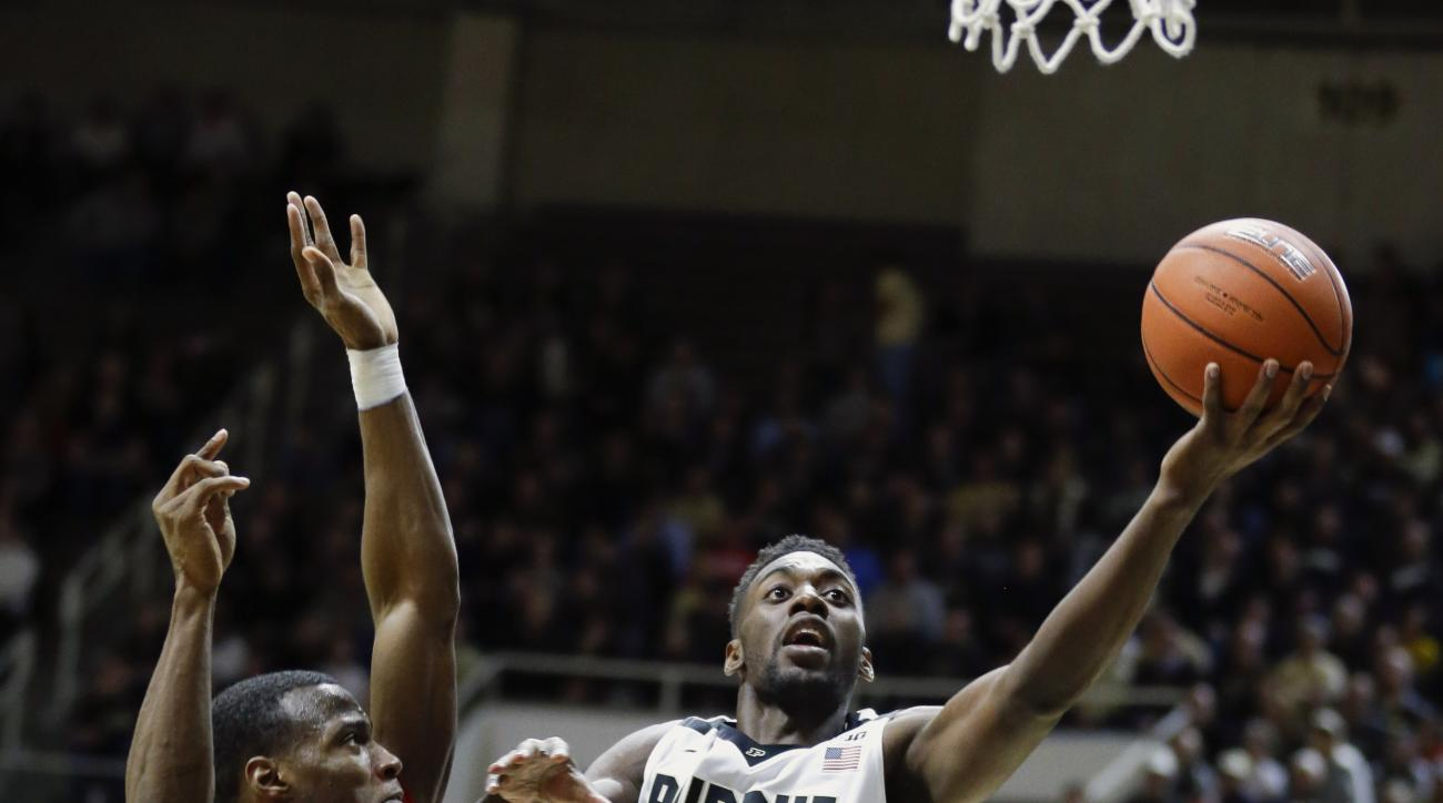 Purdue forward Jacquil Taylor (23) shoots in front of Howard guard Dalique Mingo (0) in the second half of an NCAA college basketball game in West Lafayette, Ind., Wednesday, Dec. 9, 2015.  Purdue defeated Howard 93-55. (AP Photo/Michael Conroy)
