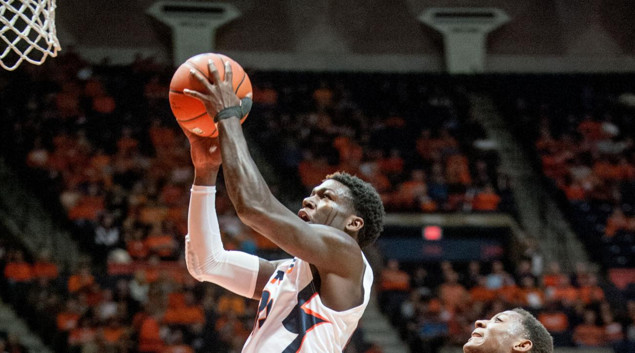 Illinois' guard Kendrick Nunn (25) goes up for a basket against Yale's forward Justin Sears (22) during the first half of an NCAA college basketball game, Wednesday, Dec. 9, 2015 in Champaign, Ill. (AP Photo/Heather Coit)