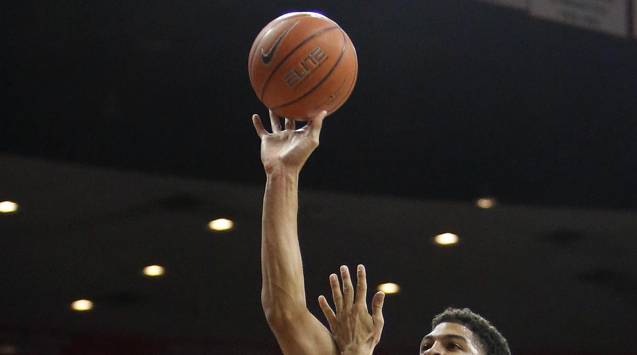 Fresno State forward Cullen Russo (13) shoots over Arizona forward Mark Tollefsen during the first half of an NCAA college basketball game, Wednesday, Dec. 9, 2015, in Tucson, Ariz. (AP Photo/Rick Scuteri)