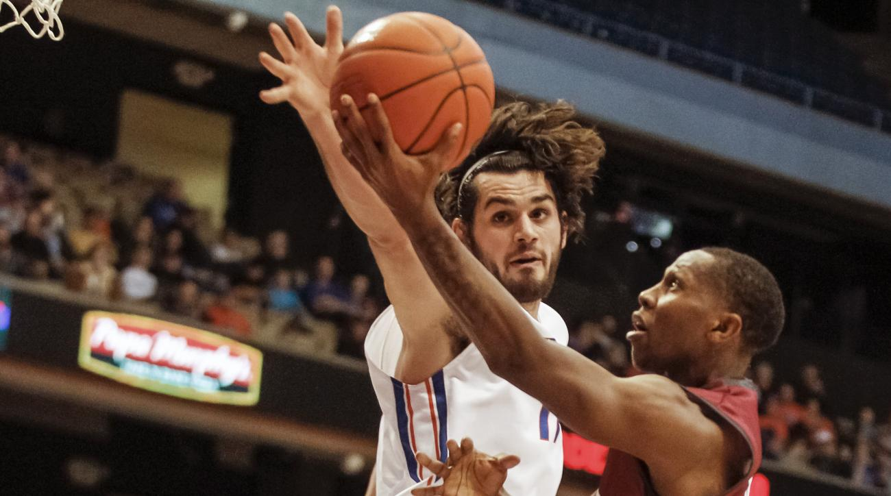Loyola Marymount's Brandon Brown shoots past Boise State's Zach Haney during the first half of an NCAA college basketball game in Boise, Idaho, on Wednesday, Dec. 9, 2015. (AP Photo/Otto Kitsinger)