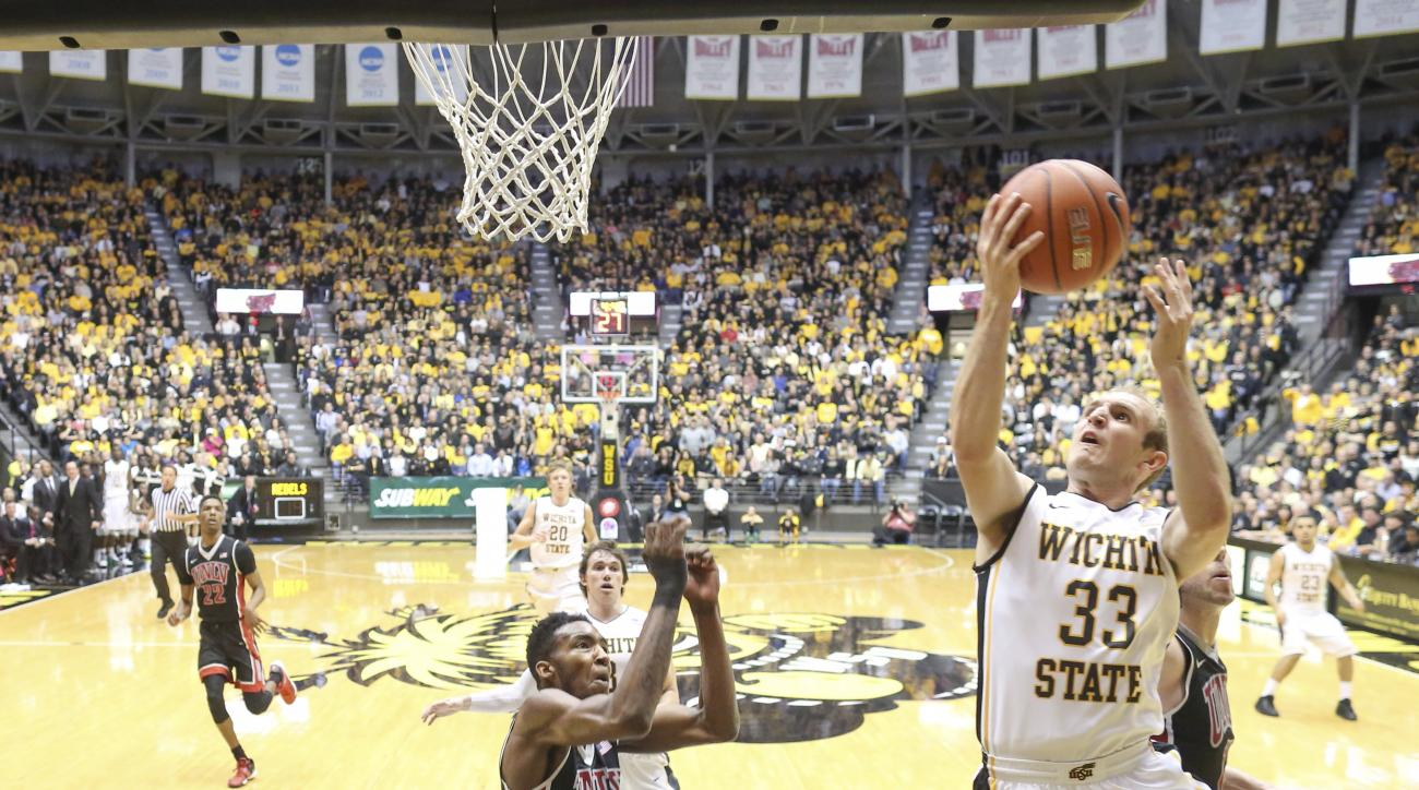 Wichita State guard Conner Frankamp drives to the basket against UNLV forward Dwayne Morgan during the first half of an NCAA college basketball game on Wednesday, Dec. 9, 2015, in Wichita, Kan. (Travis Heying/The Wichita Eagle via AP) LOCAL TELEVISION OUT