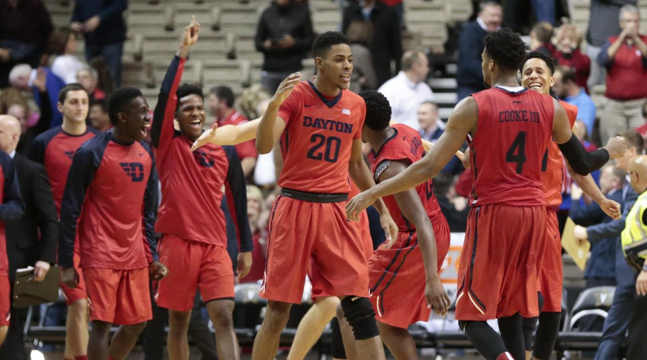 Dayton players, including Xeryius Williams (20) and Charles Cooke (4) celebrate after beating Vanderbilt in an NCAA college basketball game Wednesday, Dec. 9, 2015, in Nashville, Tenn. Dayton upset Vanderbilt 72-67. (AP Photo/Mark Humphrey)