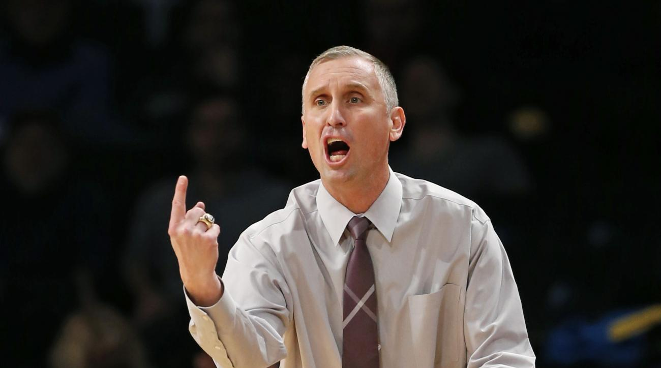 FILE - In this Nov. 23, 2015 file photo, Arizona State head coach Bobby Hurley gestures in the first half of a Legends Classic semifinal against North Carolina State in an NCAA college basketball game, in New York. Hurley took Buffalo to Kentucky for a ch