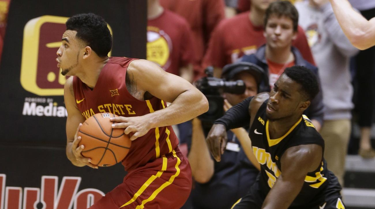 Iowa State guard Naz Mitrou-Long drives past Iowa guard Anthony Clemmons, right, during the second half of an NCAA college basketball game, Thursday, Dec. 10, 2015, in Ames, Iowa. Iowa State won 83-82. (AP Photo/Charlie Neibergall)