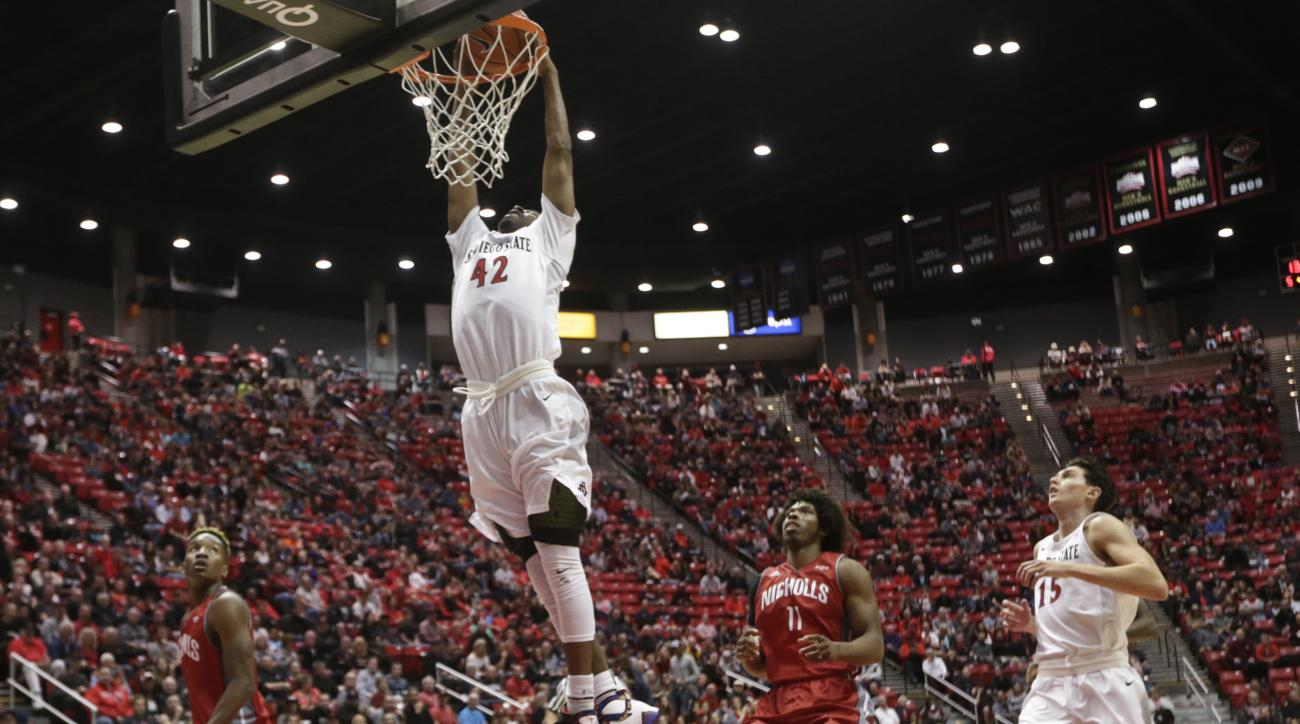 San Diego State guard Jeremy Hemsley goes in for a dunk to finish off a fast break against the Nicholls State in the first  half of a NCAA basketball game Thursday, Dec. 10, 2015, in San Diego.  (AP Photo/Lenny Ignelzi)