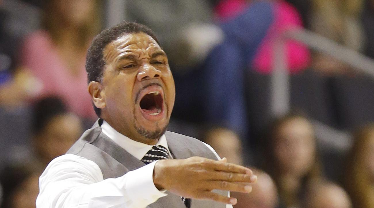 Providence head coach Ed Cooley screams as he attempts to direct his team during the first half of an NCAA college basketball game against Bryant, Saturday, Dec. 12, 2015, in Providence, R.I. (AP Photo/Stephan Savoia)