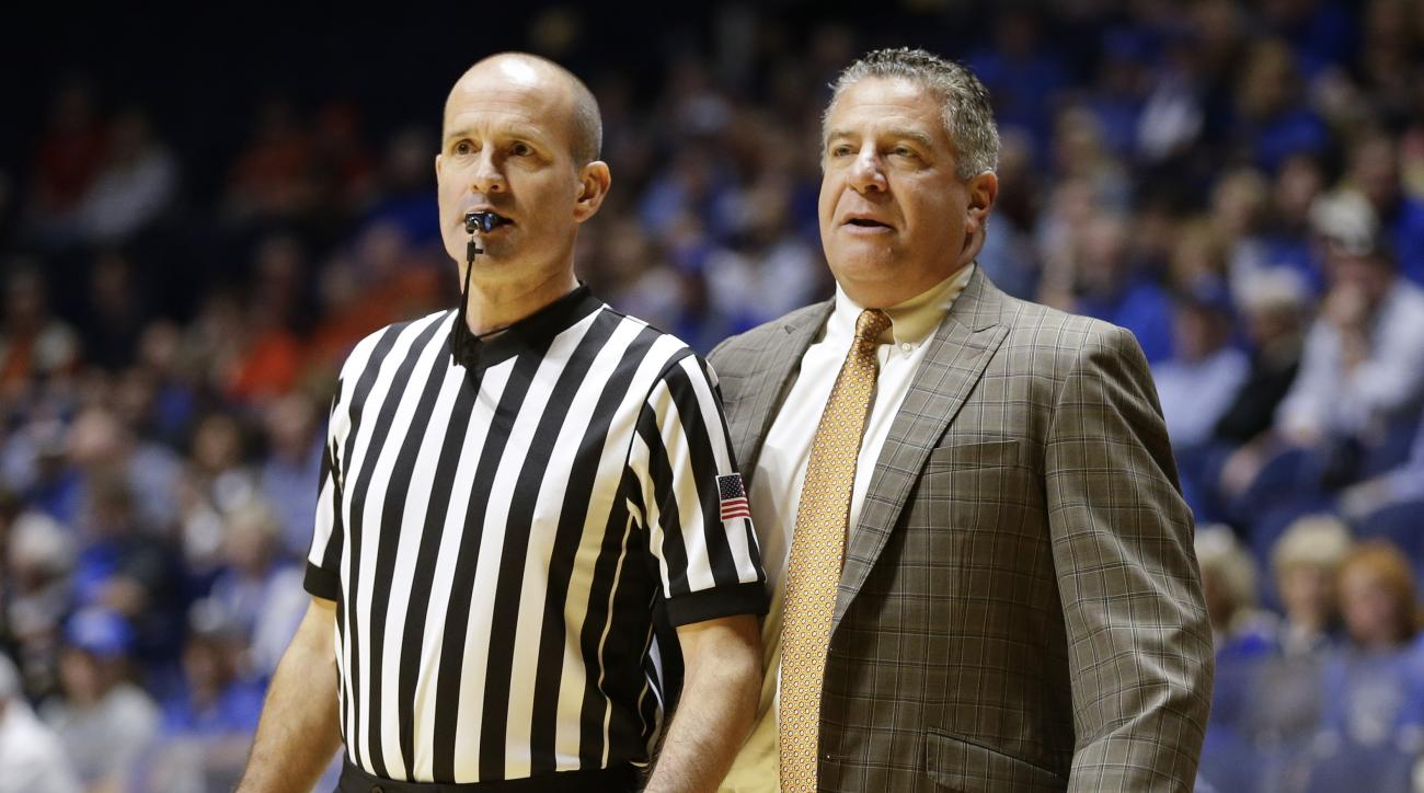 Auburn head coach Bruce Pearl watches from the bench alongside a referee during the first half of an NCAA college basketball game against Middle Tennessee Saturday, Dec. 12, 2015, in Nashville, Tenn. (AP Photo/Mark Humphrey)