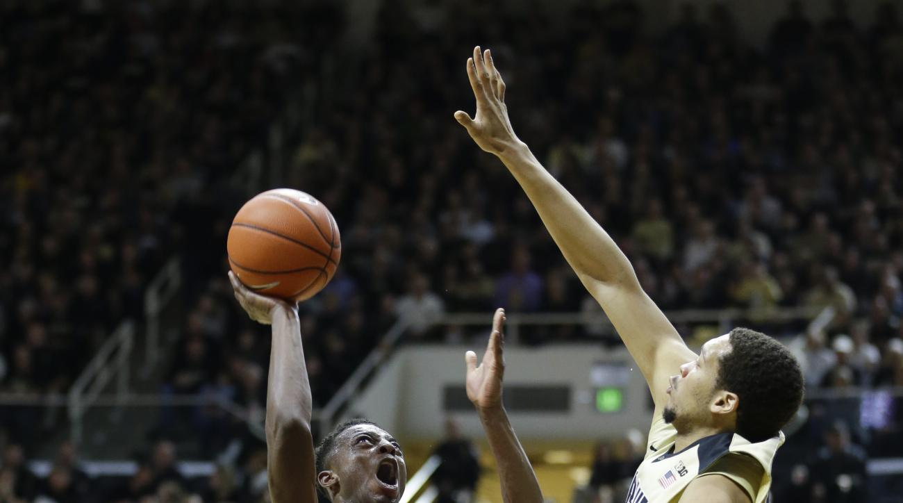 Youngstown State forward Sidney Umude (5) tries to shoot over Purdue center A.J. Hammons (20) in the first half of an NCAA college basketball game in West Lafayette, Ind., Saturday, Dec. 12, 2015. (AP Photo/Michael Conroy)