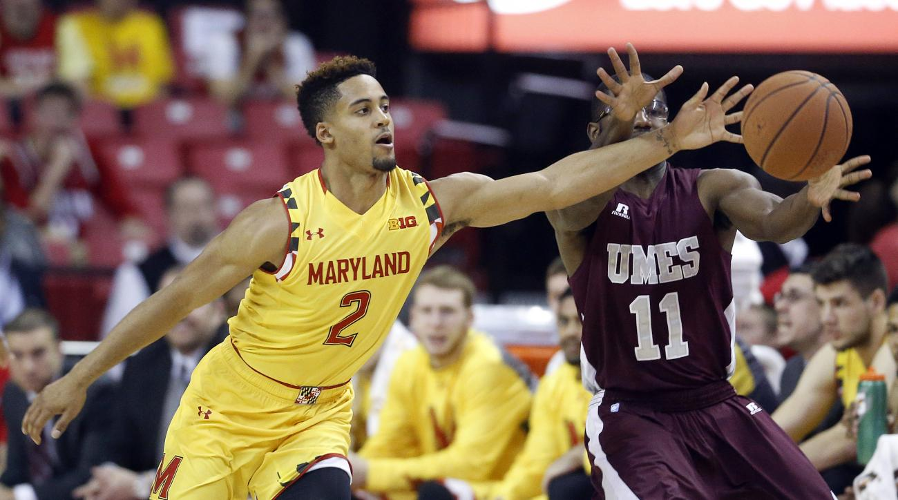 Maryland guard Melo Trimble, left, tries to steal the ball from Maryland Eastern Shore guard Ahmad Frost in the first half of an NCAA college basketball game, Saturday, Dec. 12, 2015, in College Park, Md. (AP Photo/Patrick Semansky)