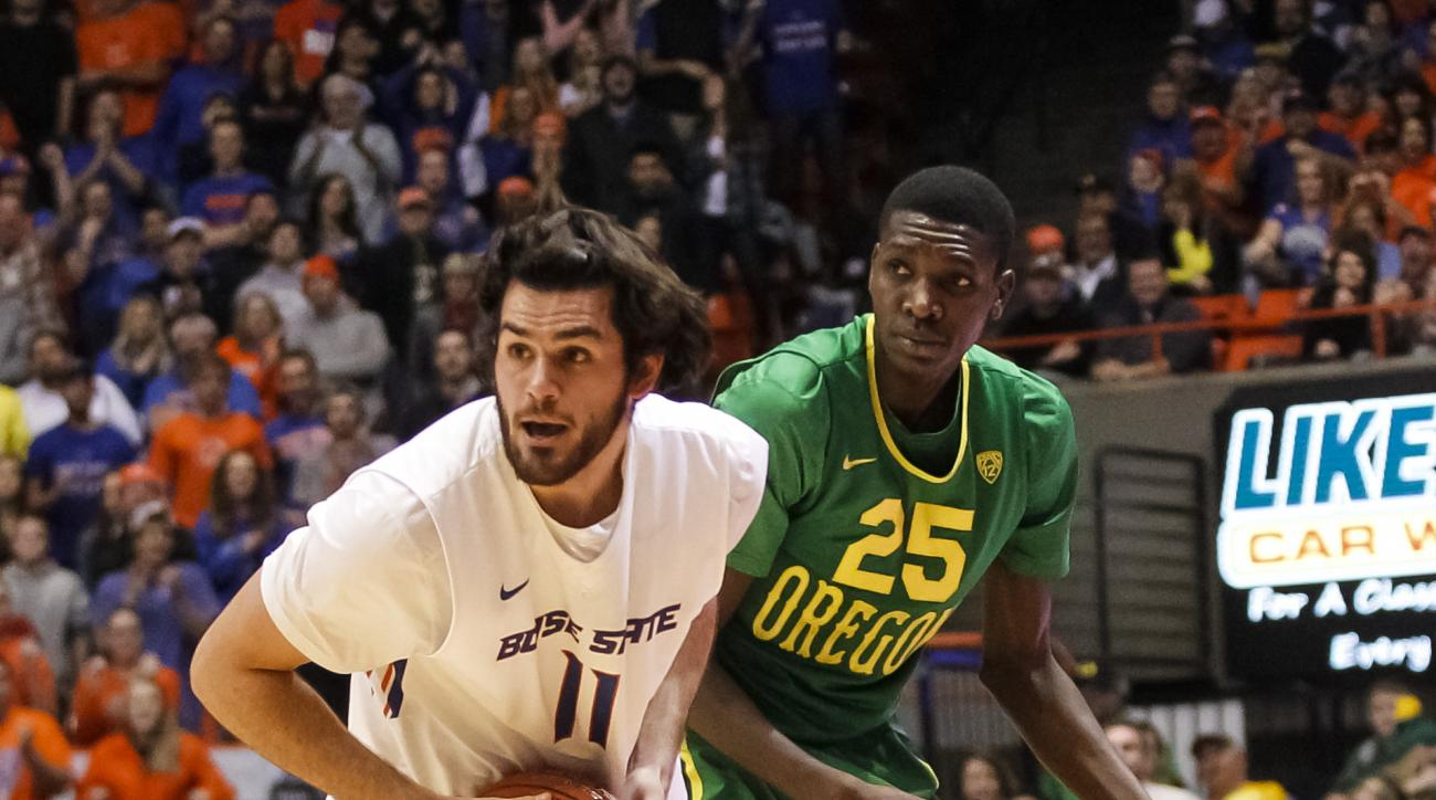 Boise State's Zach Haney (11) grabs a loose ball in front of Oregon's Chris Boucher (25) during the first half of an NCAA college basketball game in Boise, Idaho, on Saturday, Dec. 12, 2015. (AP Photo/Otto Kitsinger)