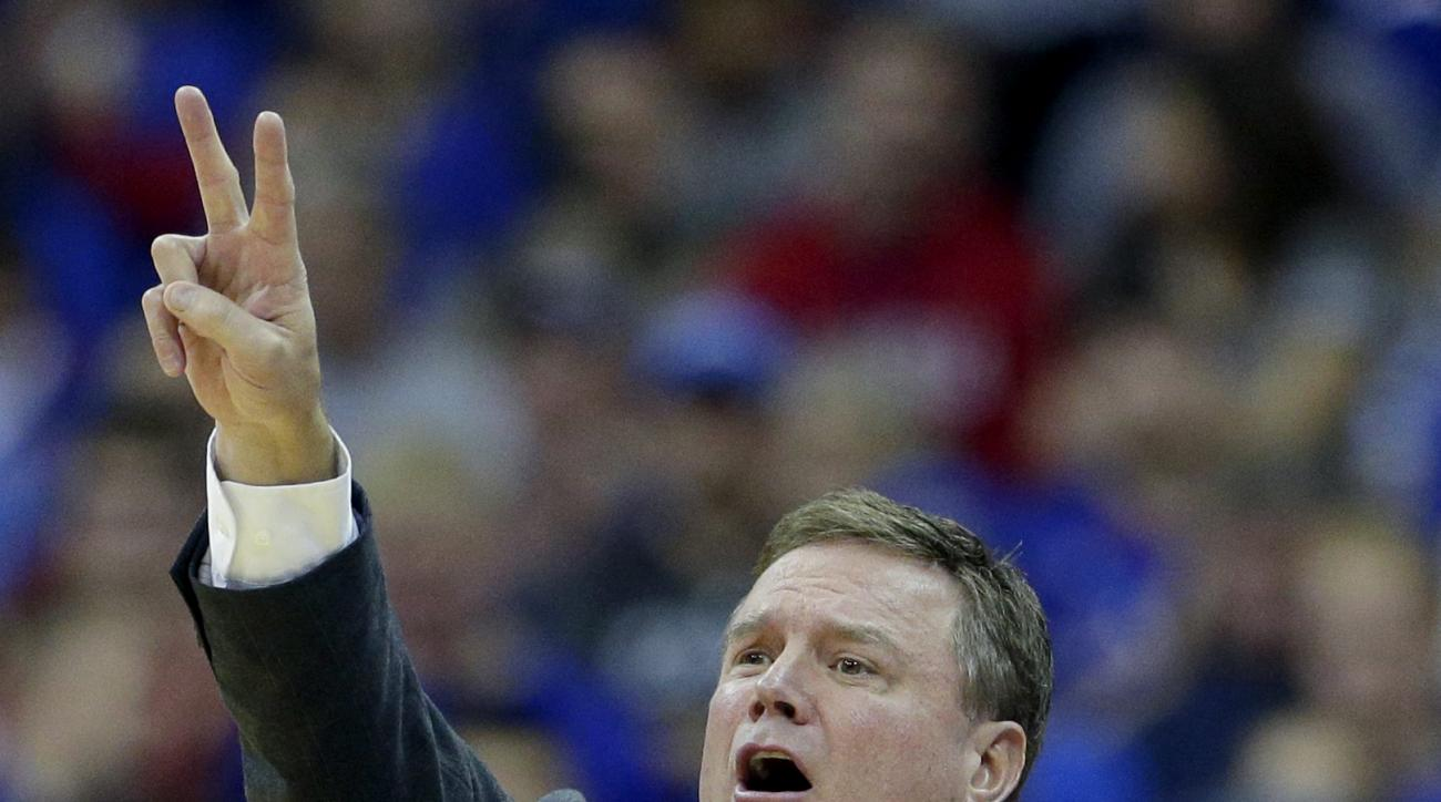Kansas head coach Bill Self talks to his players during the first half of an NCAA college basketball game against Oregon State Saturday, Dec. 12, 2015, at Sprint Center in Kansas City, Mo. (AP Photo/Charlie Riedel)