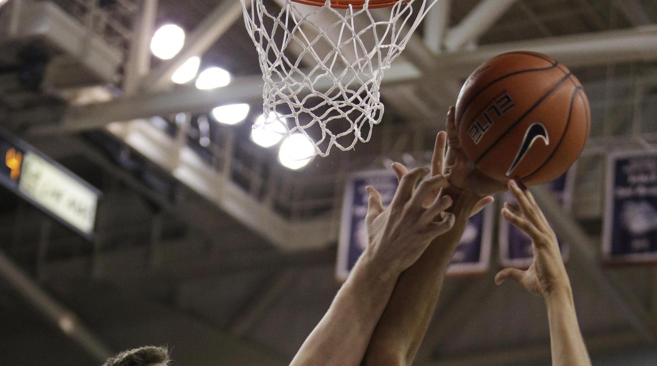 UCLA's Jonah Bolden (43) and Gonzaga's Ryan Edwards (25) go after a rebound during the first half of an NCAA college basketball game, Saturday, Dec. 12, 2015, in Spokane, Wash. (AP Photo/Young Kwak)