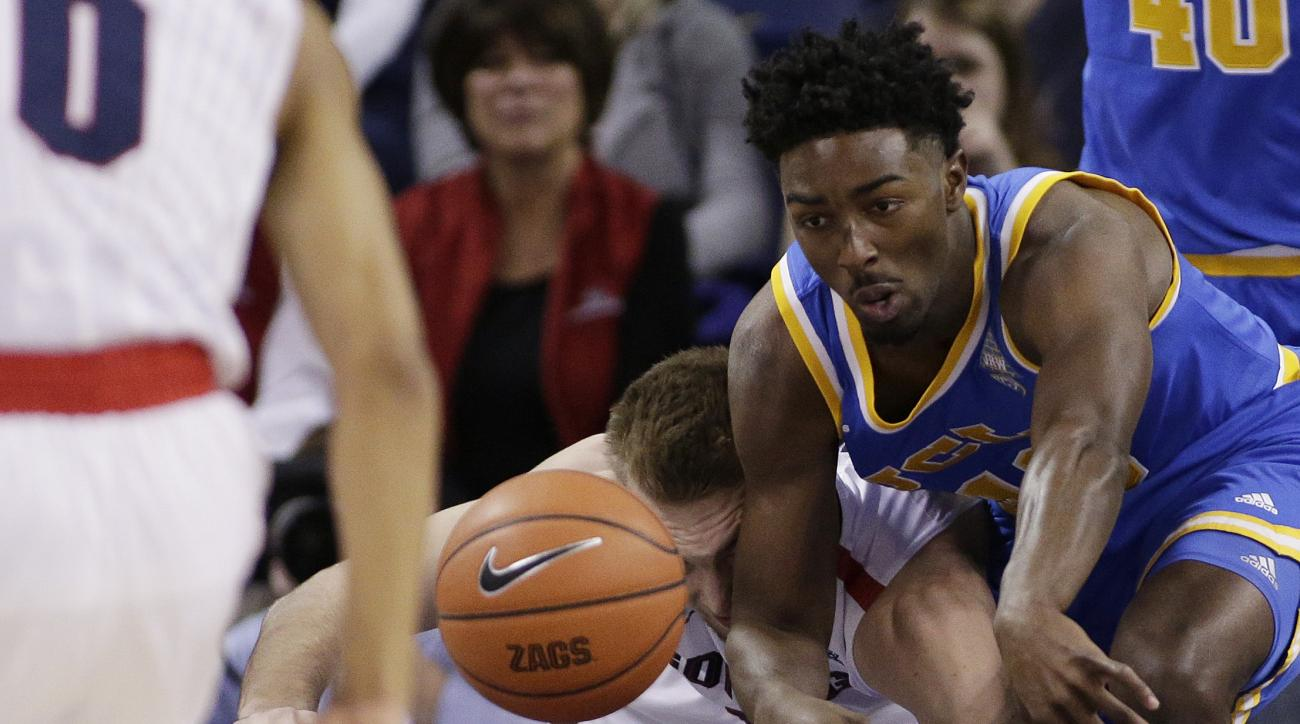 UCLA's Isaac Hamilton, right, goes after a loose ball against Gonzaga's Domantas Sabonis during the first half of an NCAA college basketball game, Saturday, Dec. 12, 2015, in Spokane, Wash. (AP Photo/Young Kwak)