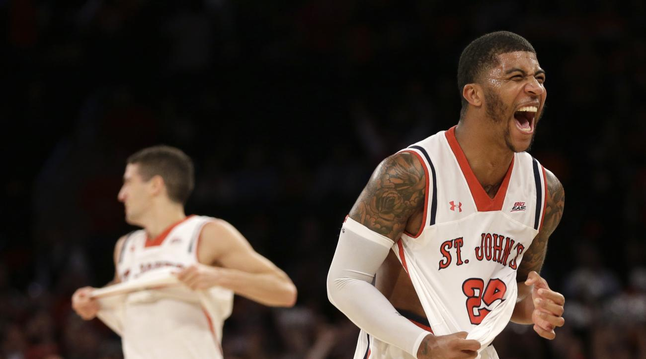 St. John's Ron Mvouika, right, and Federico Mussini react at the end of an NCAA college basketball game against Syracuse, Sunday, Dec. 13, 2015, in New York. St. John's defeated Syracuse 84-72. (AP Photo/Seth Wenig)