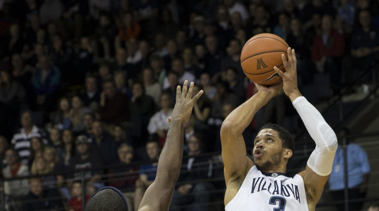 Villanova guard Josh Hart (3) shoots for three points past La Salle guard Jordan Price (21) in the first half of an NCAA college basketball game, Sunday, Dec. 13, 2015, in Villanova, Pa. (AP Photo/Laurence Kesterson)