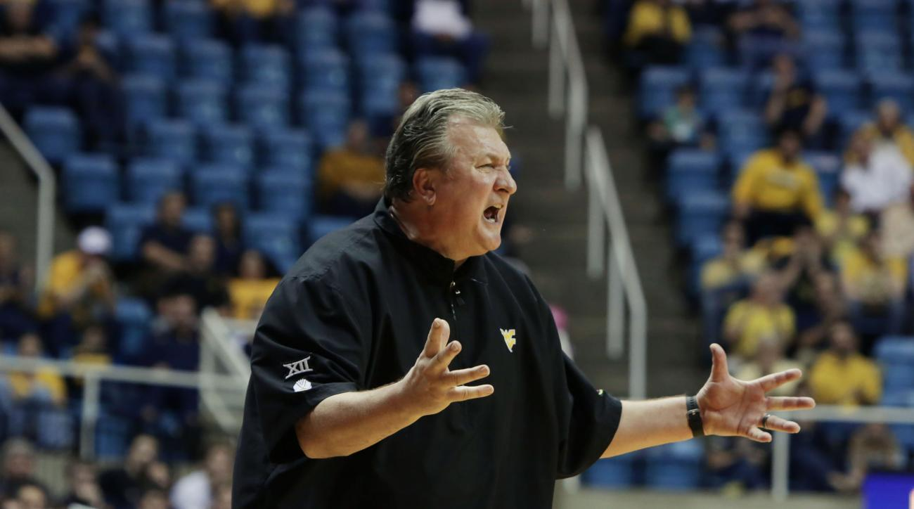 West Virginia head coach Bob Huggins screams at this players during the second half of an NCAA college basketball game against Louisiana-Monroe, Sunday, Dec, 13, 2015, in Morgantown, W.Va. West Virginia defeated Louisiana-Monroe 100-58.  (AP Photo/Raymond