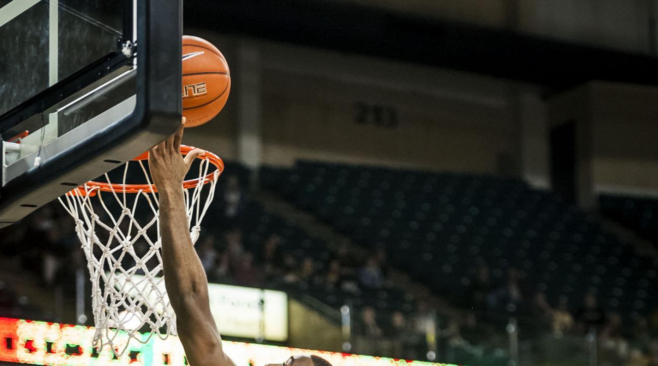 Wake Forest  guard Codi Miller-McIntyre (0) shoots over UNC Greensboro  guard Asad Lamot (2) during an NCAA college basketball game, Tuesday, Dec. 15, 2015 at Joel Coliseum in Winston-Salem, N.C. (Andrew Dye/The Winston-Salem Journal via AP) MANDATORY CRE