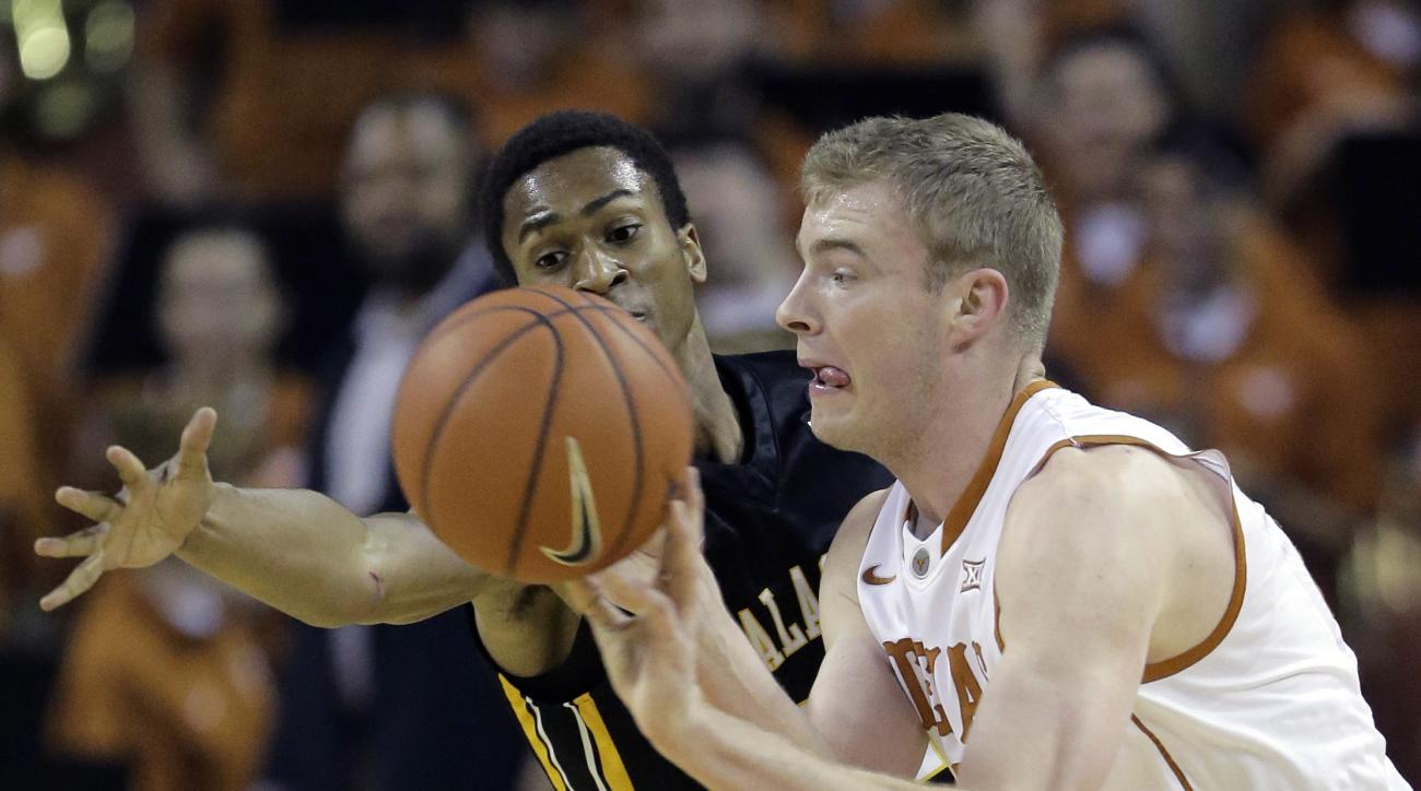 Texas forward Connor Lammert, right, passes around Appalachian State guard Frank Eaves, left, during the first half of an NCAA college basketball game, Tuesday, Dec. 15, 2015, in Austin, Texas. (AP Photo/Eric Gay)