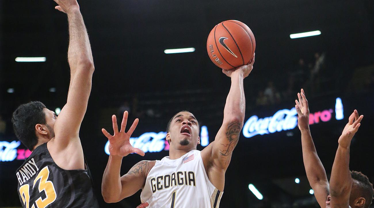 Georgia Tech guard Tadric Jackson splits Virginia Commonwealth defenders while going to the basket during the first half of an NCAA college basketball game Tuesday, Dec. 15, 2015, in Atlanta. (Curtis Compton/Atlanta Journal Constitution via AP)