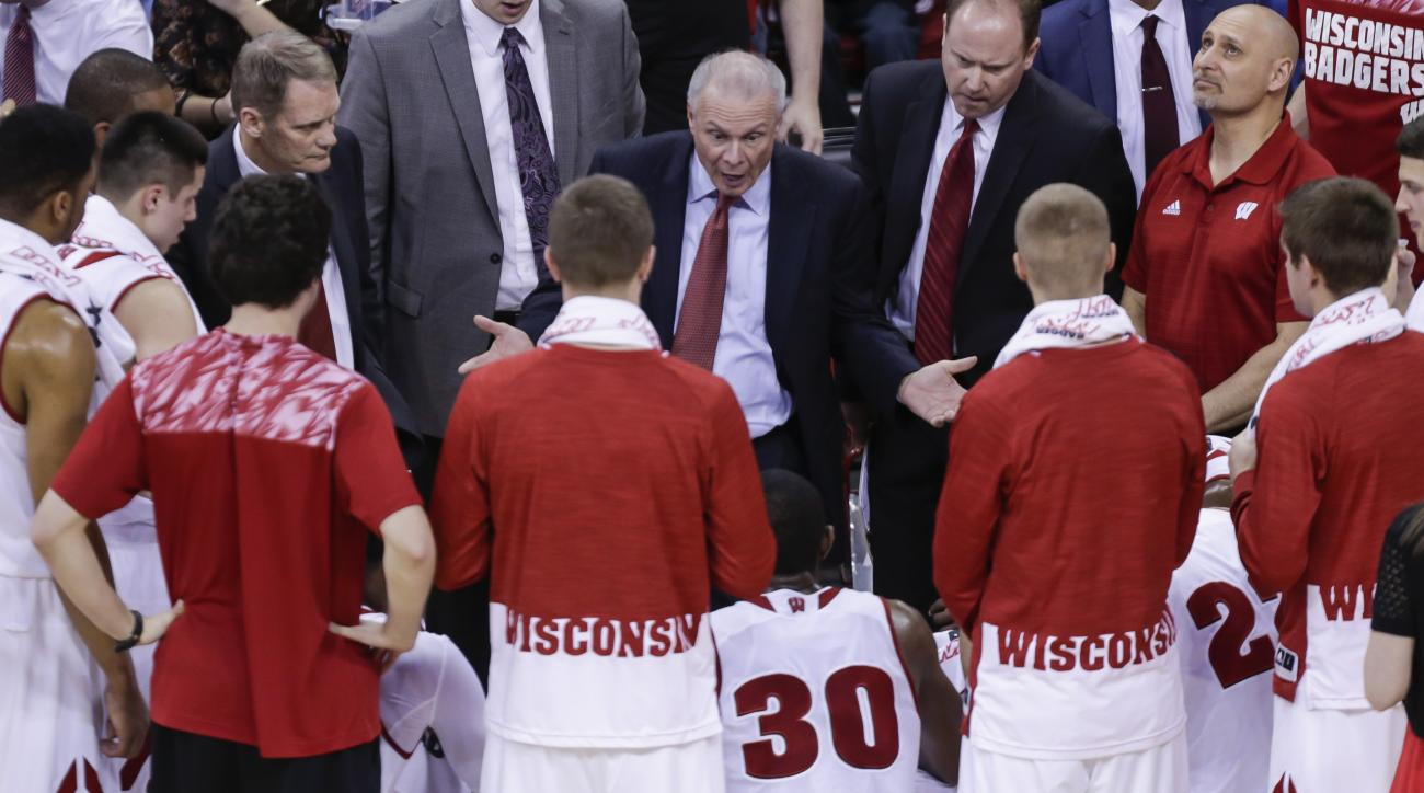 Wisconsin coach Bo Ryan, center, talks to his team during a timeout in the first half of an NCAA college basketball game against Texas A&M Corpus Christi Tuesday, Dec. 15, 2015, in Madison, Wis. (AP Photo/Andy Manis)