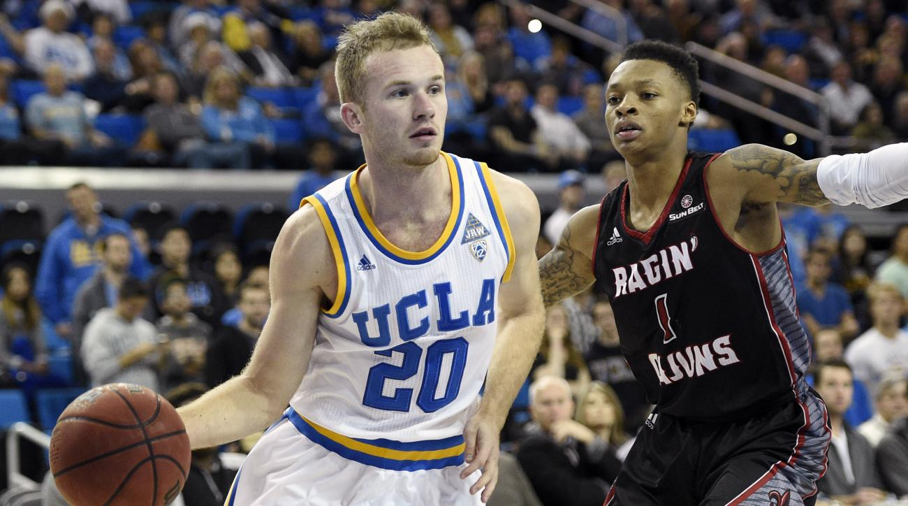 UCLA guard Bryce Alford, left, moves the ball past Louisiana-Lafayette guard Jay Wright during the second half of an NCAA college basketball game in Los Angeles, Tuesday, Dec. 15, 2015. UCLA won 89-80. (AP Photo/Kelvin Kuo)