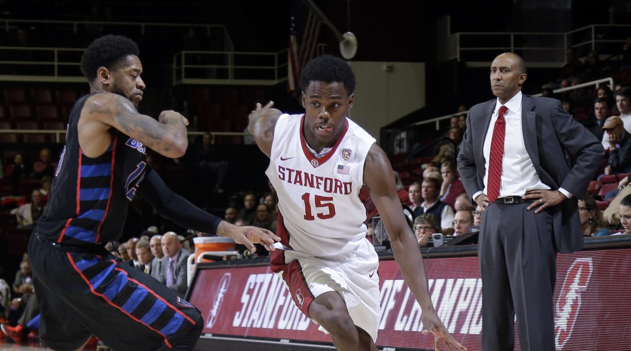 Stanford guard Marcus Allen (15) dribbles past DePaul guard Aaron Simpson during the second half of an NCAA college basketball game Tuesday, Dec. 15, 2015, in Stanford, Calif. Stanford won 79-60. (AP Photo/Marcio Jose Sanchez)