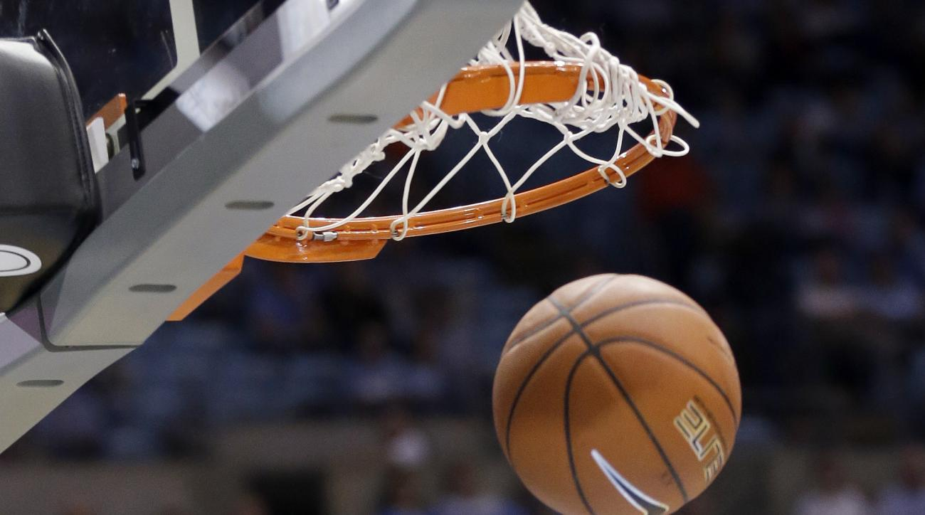 North Carolina's Brice Johnson (11) dunks against Tulane during the first half of an NCAA college basketball game in Chapel Hill, N.C., Wednesday, Dec. 16, 2015. (AP Photo/Gerry Broome)