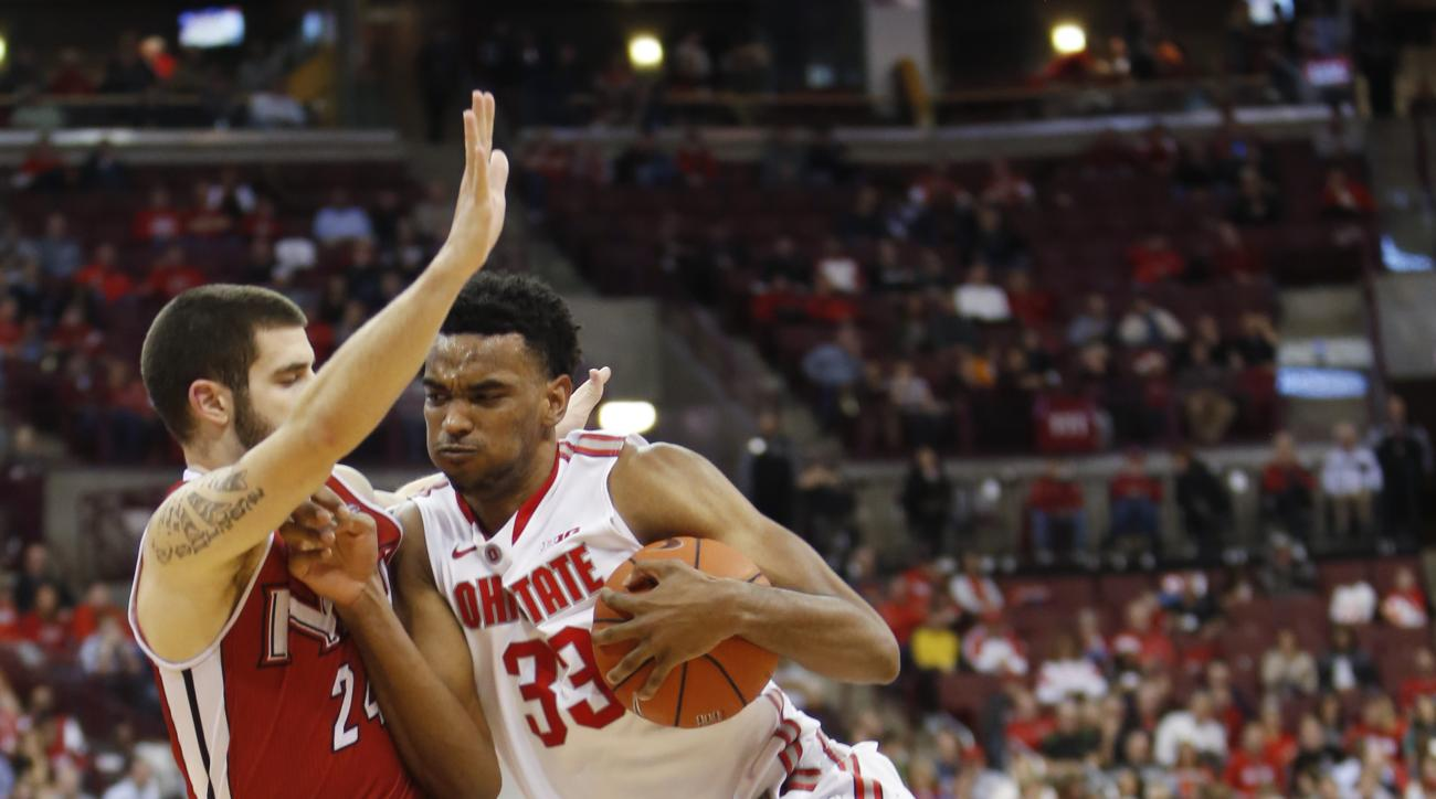 Ohio State's Keita Bates-Diop, right, drives to the basket against Northern Illinois' Michael Orris during the second half of an NCAA college basketball game Wednesday, Dec. 16, 2015, in Columbus, Ohio. Ohio State beat Northern Illinois 67-54. (AP Photo/J