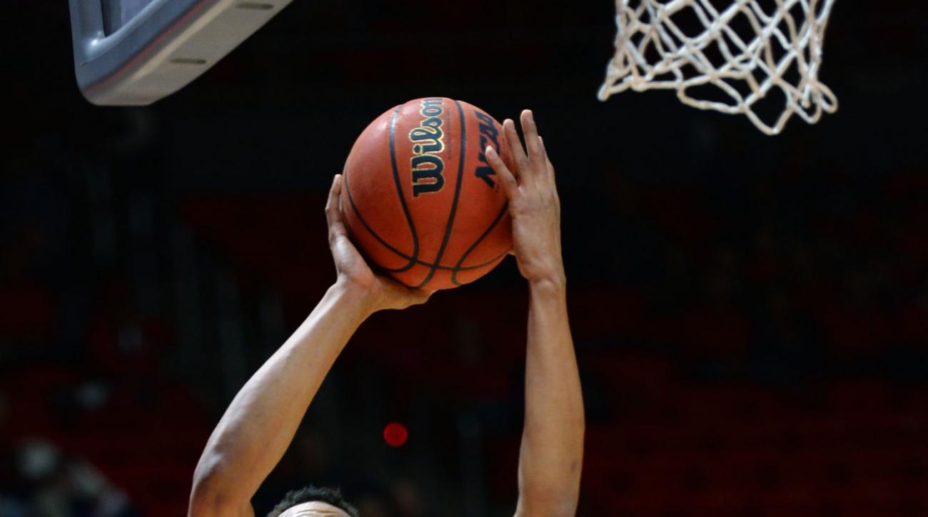 Utah guard Lorenzo Bonam (15) elevates over  Savannah State guard Isaiah Felder (15) during an NCAA college basketball game in Salt Lake City, Wednesday, Dec. 16, 2015.  (Steve Griffin/The Salt Lake Tribune via AP) DESERET NEWS OUT; LOCAL TELEVISION OUT;
