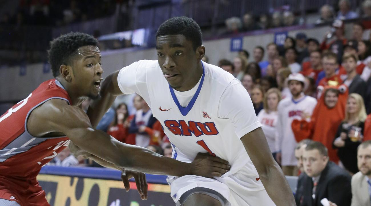 SMU guard Shake Milton (1) drives against Nicholls State guard Quinton Thomas (23)   during the first half of an NCAA college basketball game Wednesday, Dec. 16, 2015, in Dallas. SMU won 86-42. (AP Photo/LM Otero)
