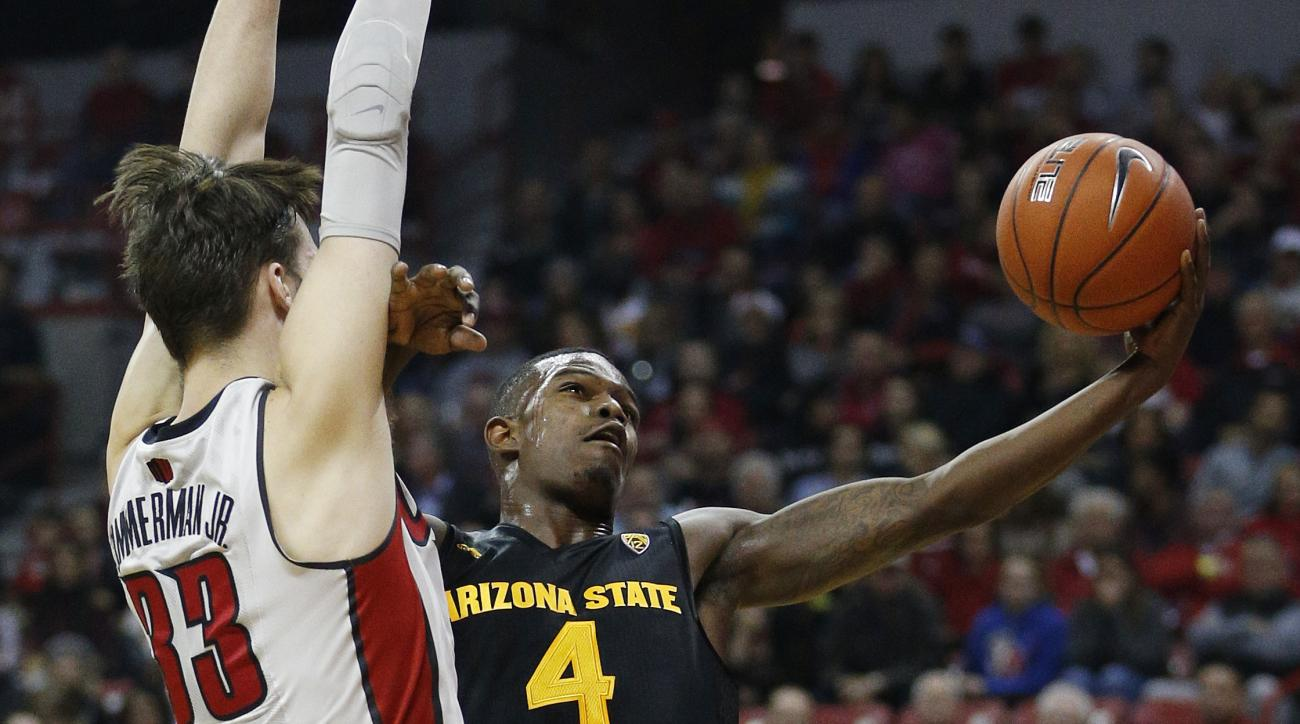 Arizona State guard Gerry Blakes shoots around UNLV forward Stephen Zimmerman Jr. during the first half of an NCAA college basketball game Wednesday, Dec. 16, 2015, in Las Vegas. (AP Photo/John Locher)