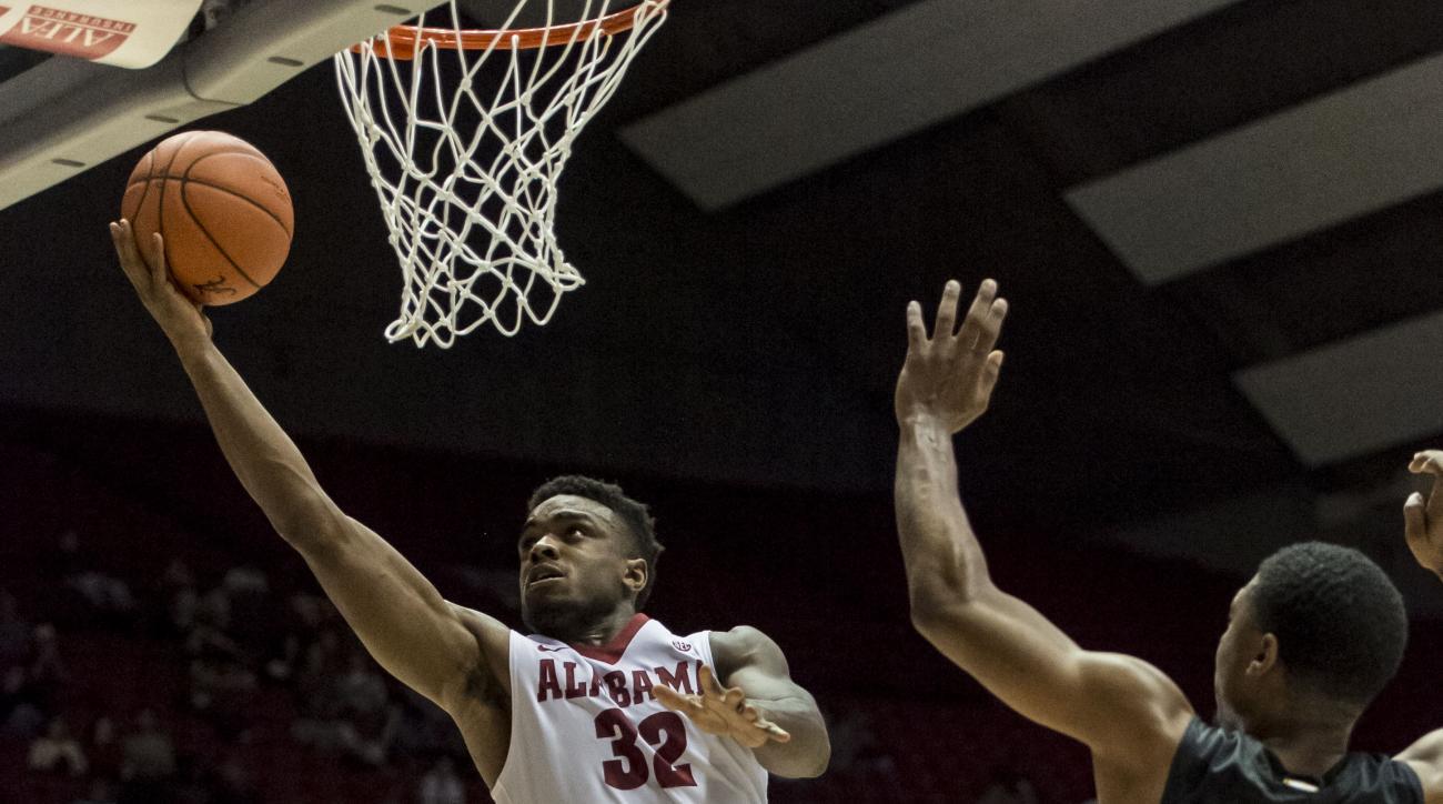 Alabama guard Retin Obasohan (32) scores against Winthrop during an NCAA college basketball game Wednesday, Dec. 16, 2015, in Tuscaloosa, Ala. (Vasha Hunt/AL.com via AP)