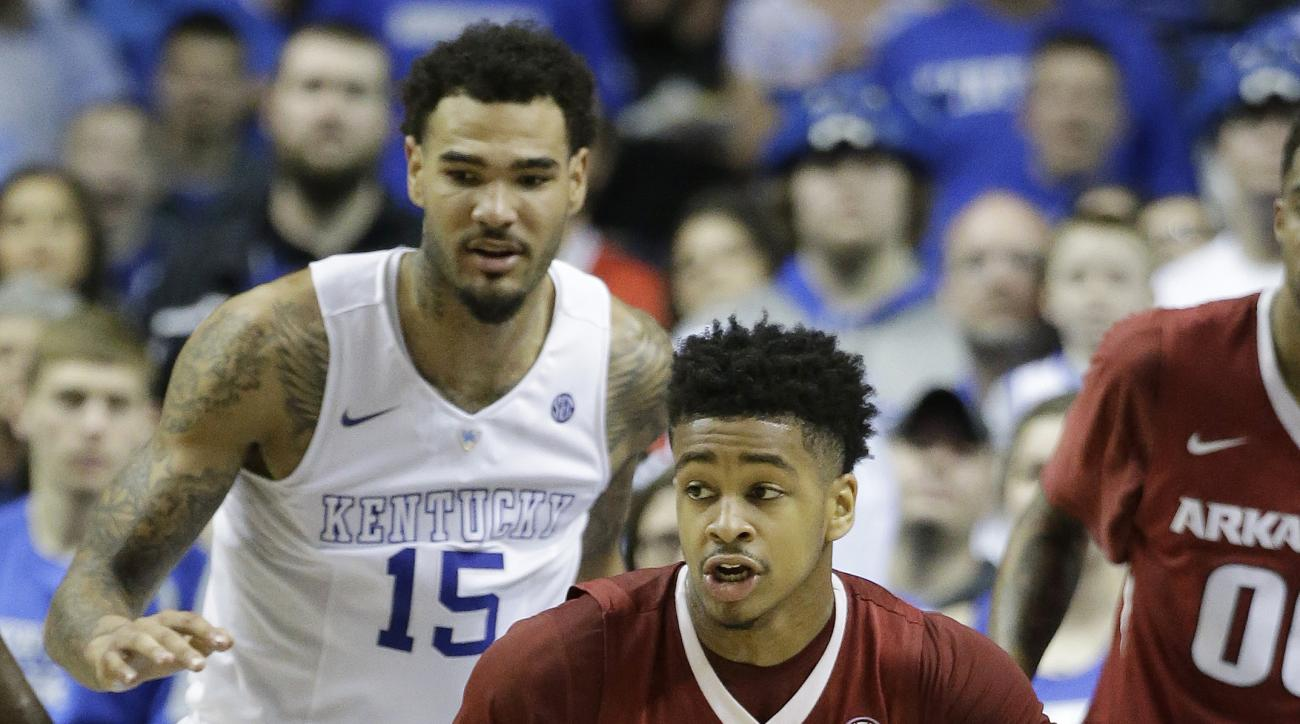 FILE - In this March 15, 2015, file photo, Arkansas guard Anton Beard (31) takes the ball up court as Kentucky forward Willie Cauley-Stein (15) looks on during the second half of the NCAA college basketball Southeastern Conference tournament championship