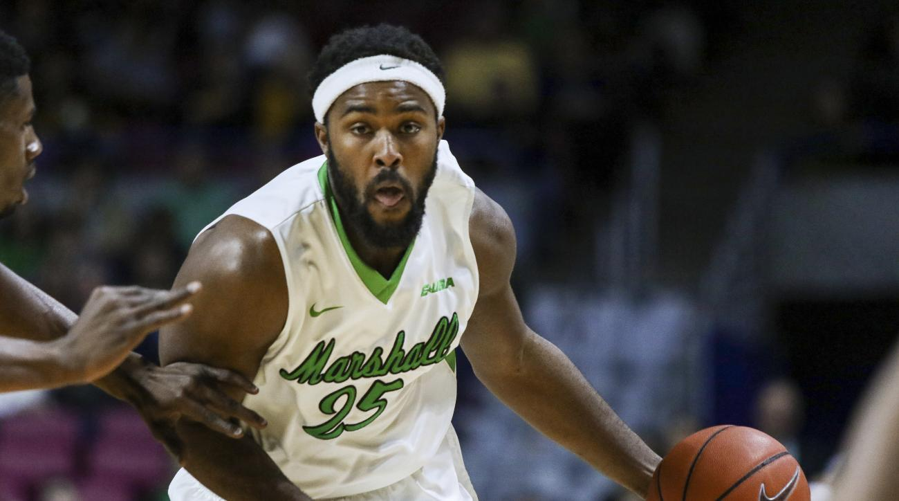 Marshall's Ryan Taylor drives against West Virginia during an NCAA college basketball game in Charleston, W.Va., on Thursday, Dec. 17, 2015. (AP Photo/Tyler Evert)