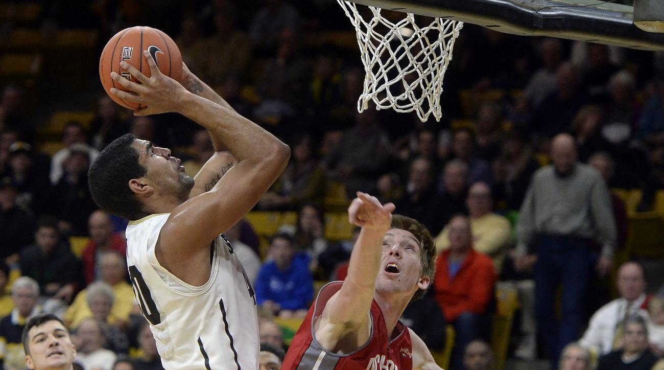 Colorado's Josh Scott drives to the hoop over Nicholls State's Liam Thomas during an NCAA college basketball game, Friday Dec. 18, 2015 in Boulder, Colo. (Jeremy Papasso/Daily Camera via AP) NO SALES; MANDATORY CREDIT