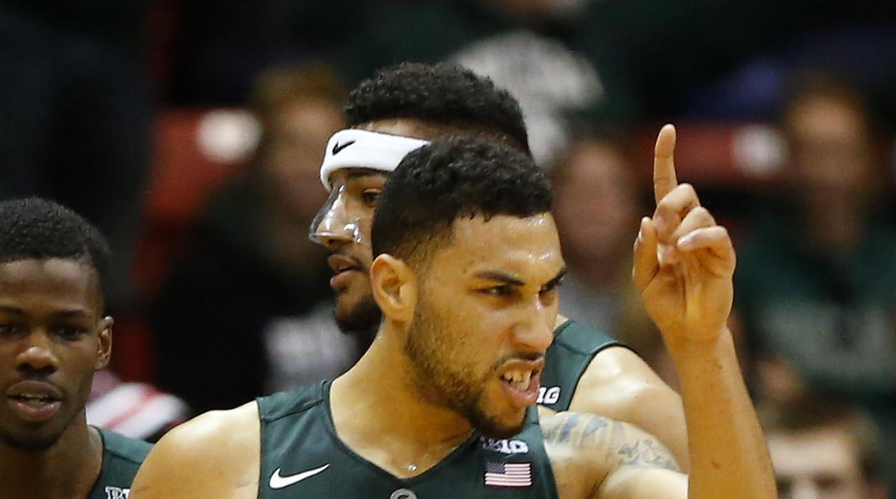 Michigan State's Denzel Valentine reacts after sinking a basket against Northeastern during the second half of a NCAA college basketball game in Boston Saturday, Dec. 19, 2015. (AP Photo/Winslow Townson)