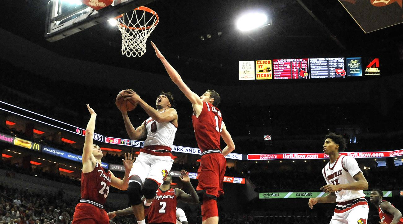 Louisville's Damion Lee (0) splits the defense of Western Kentucky's Justin Johnson (23) and Ben Lawson (14) for a layup during the second half of an NCAA college basketball game, Saturday, Dec. 19, 2015, in Louisville, Ky. Louisville won 78-56. (AP Photo