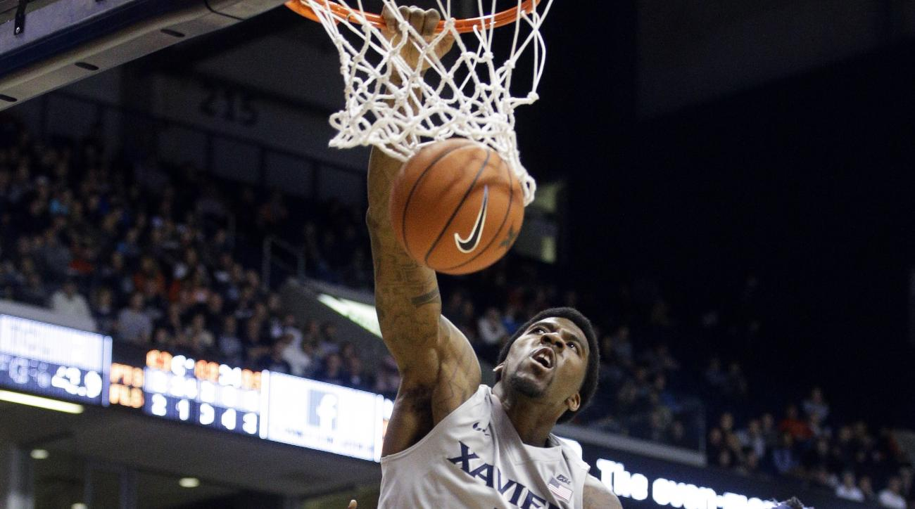 Xavier's Jalen Reynolds (1) dunks over Auburn's Horace Spencer (0) and Cinmeon Bowers (5) in the second half of an NCAA college basketball game, Saturday, Dec. 19, 2015, in Cincinnati. Xavier won 85-61. (AP Photo/John Minchillo)