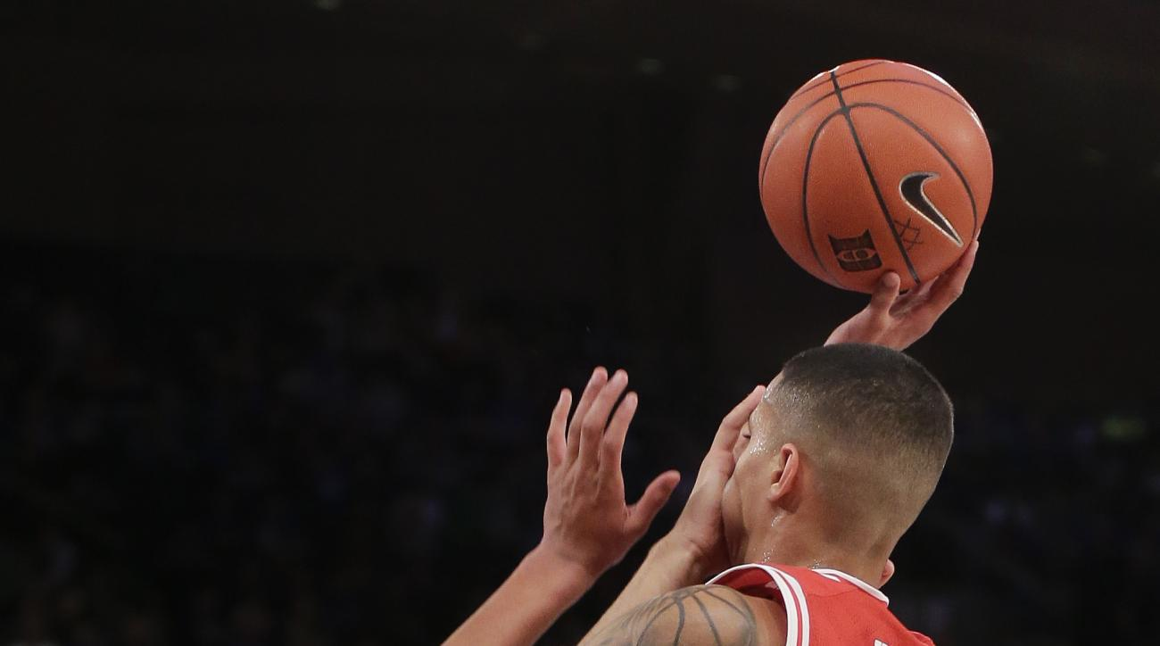 Duke forward Chase Jeter (2) tries to draw a foul on Utah  forward Kyle Kuzma (35) during the second half of an NCAA college basketball game, Saturday, Dec. 19, 2015, in New York. Utah won 77-75 in overtime. (AP Photo/Julie Jacobson)