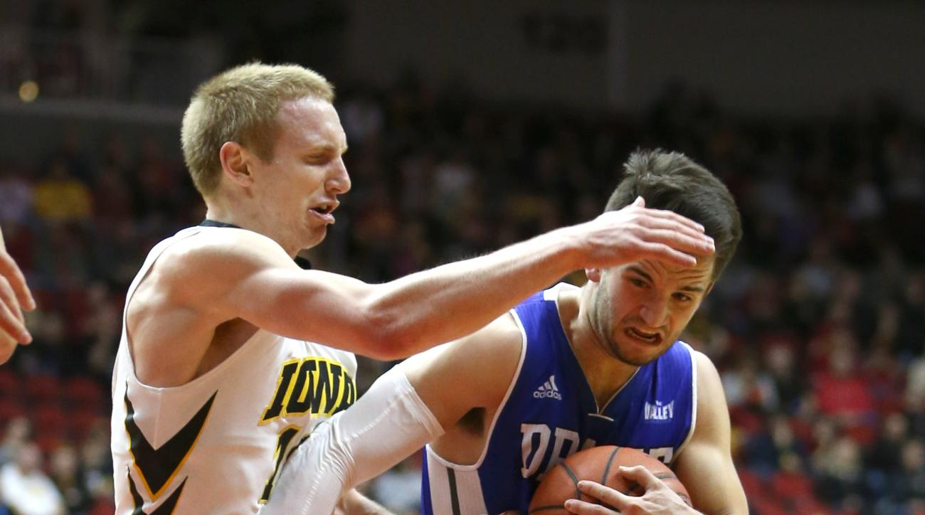 Drake guard Graham Woodward tries to drive past Iowa guard Mike Gesell during the first half of an NCAA college basketball game, Saturday, Dec. 19, 2015, in Des Moines, Iowa. (AP Photo/Justin Hayworth)
