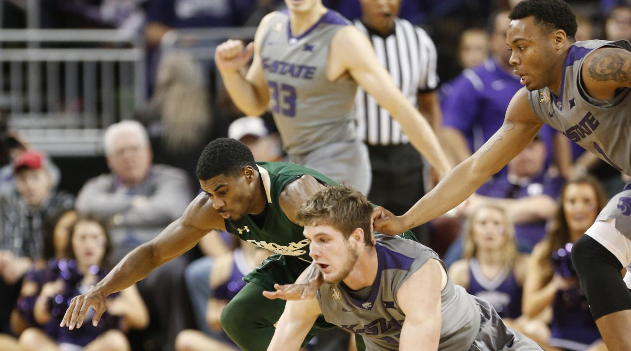 Colorado State guard Antwan Scott (1) and Kansas State forward Dean Wade (32) dive for a loose ball during an NCAA college basketball game, Saturday, Dec. 19, 2015 in Wichita, Kan. (Bo Rader/The Wichita Eagle via AP) LOCAL TELEVISION OUT; MAGS OUT; LOCAL