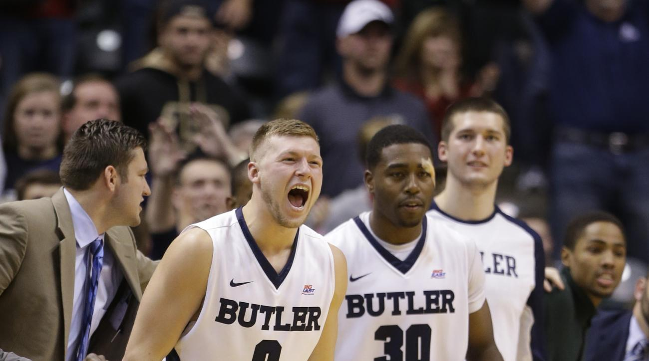 Butler forward Austin Etherington (0) and forward Kelan Martin (30) celebrate on the bench in the second half of an NCAA college basketball game against Purdue in Indianapolis, Saturday, Dec. 19, 2015. Butler defeated Purdue 74-68. (AP Photo/Michael Conro