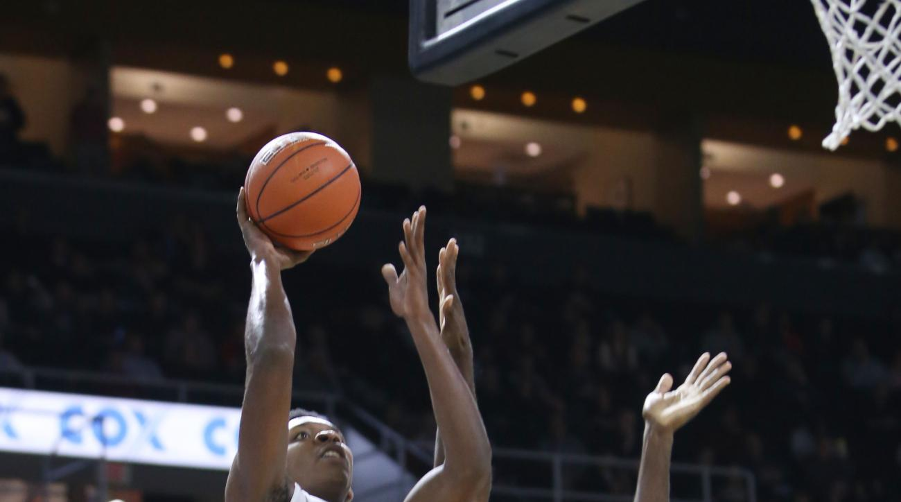 Providence's Rodney Bullock (5) shoots over Rider's Khalil Alford (15) during the first half of their NCAA college basketball game in Providence, R.I., on Saturday, Dec. 19, 2015. (AP Photo/Joe Giblin)