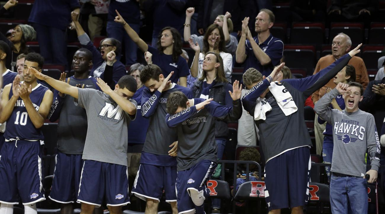 Monmouth players on the bench react to a play in the final seconds of the second half of an NCAA college basketball game, Sunday, Dec. 20, 2015, in Piscataway, N.J. Monmouth  won 73-67. (AP Photo/Mel Evans)